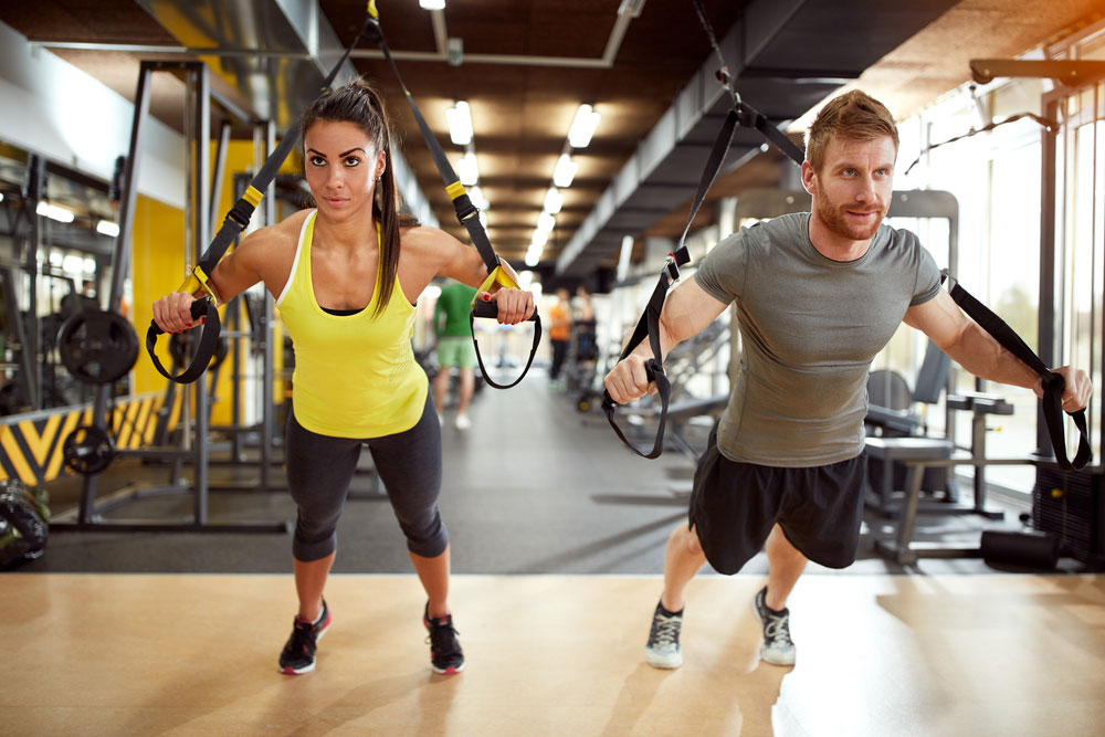 Female and male van drivers excersing at the gym